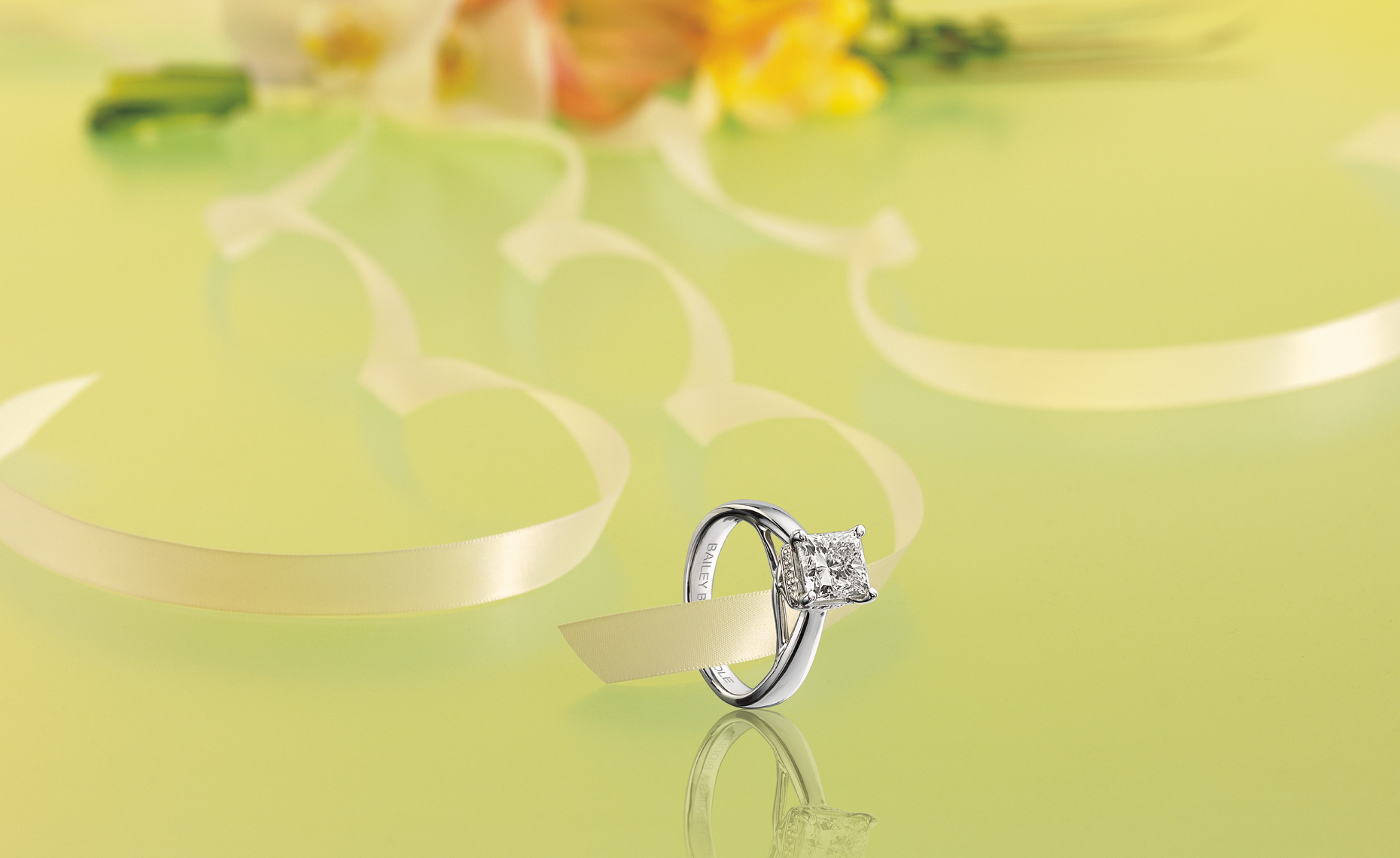 Princess cut, radiant diamond solitaire engagement ring.