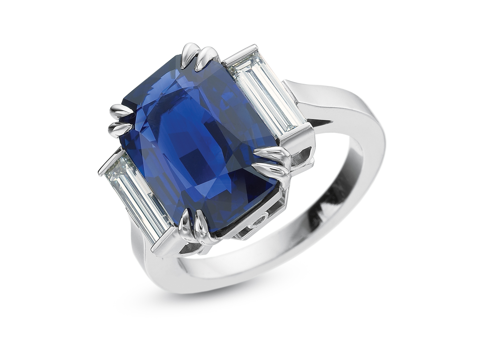Emerald cut sapphire with baguette diamond side stones platinum ring.